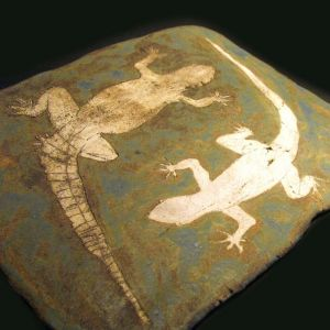 Lizards, drawing on clay